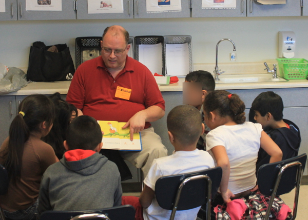 David Rodeback reading Dr. Seuss to third-graders at Woodrow Wilson Elementary.